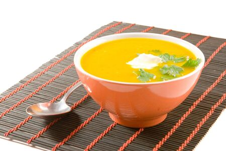 Pumpkin soup with spoon Stock Photo