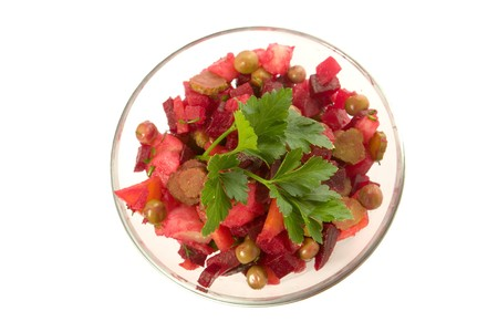 beetroot salad decorated with parsley on white ground photo