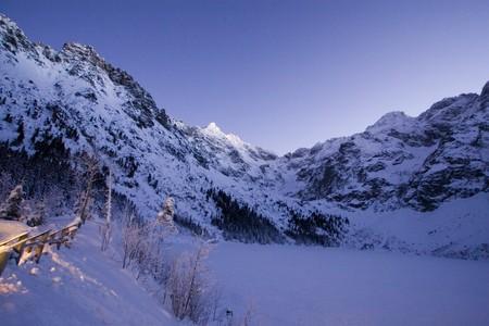 Frozen lake in Tatra mountain photo