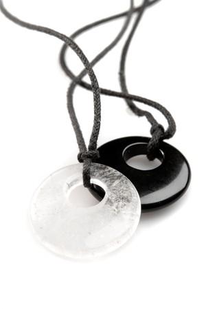 pendent: Onyx and quartz pendent on white ground Stock Photo