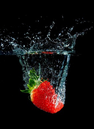 Strawberry in water with bubbles on black ground Stock Photo - 4262368
