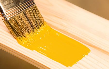 Painting wooden detail with yellow color