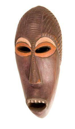 Wooden ethnic mask on white ground photo