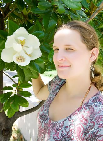 Young woman holding white magnolia Stock Photo - 5642294