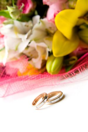 Composition of two wedding rings and flowers photo