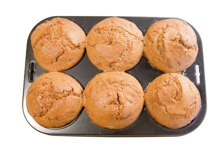 white backing: brown muffins in backing tray on white ground Stock Photo