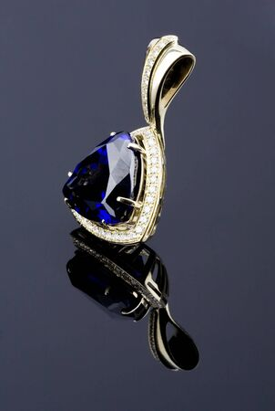 pendent: pendent with big blue gem and diamonds
