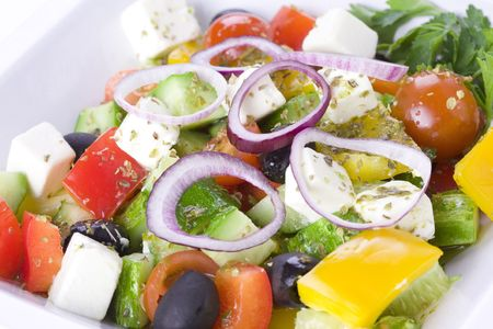 Greek Salad in white bowl photo