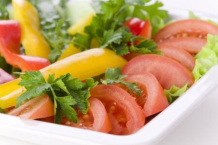 Fresh vegetables on white plate photo