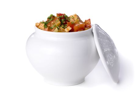 Vegetables with herbs in white pot photo