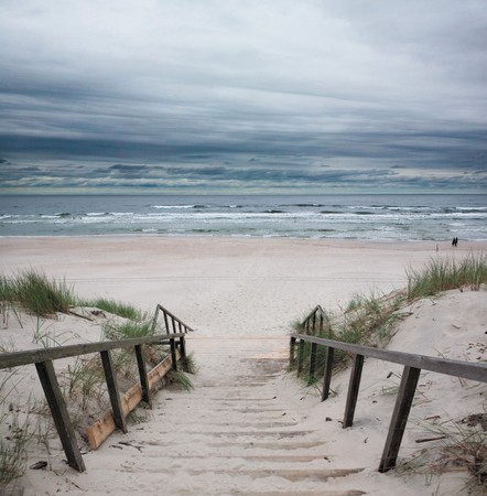 Wooden way to the beach on baltic sea photo