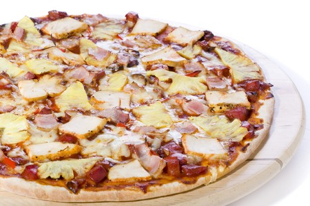 ham and pineapple pizza on white ground Stock Photo