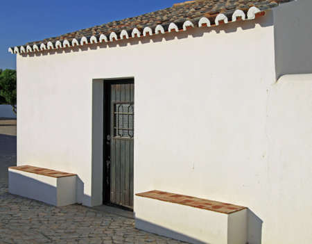 Ancient typical house in Algarve, Portugal, at the end of the afternoon