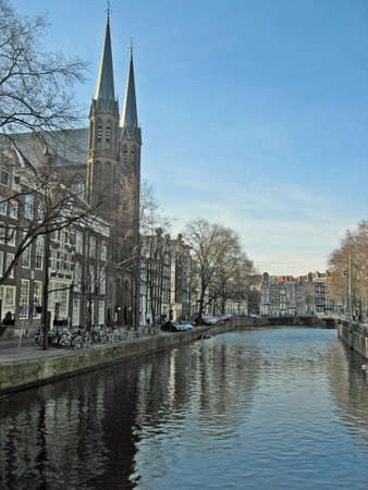 Church and houses near the canal, in Amsterdam Stock Photo