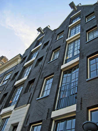 Modern Amsterdam builidings using the old style facades