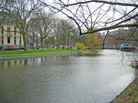 View of a wide part of a canal in Amsterdam, Netherlands Stock Photo