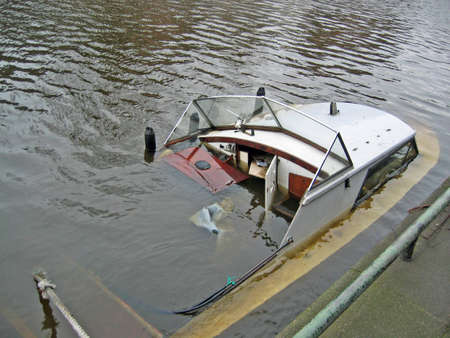 bad accident: Sunken boat in an Amsterdam canal