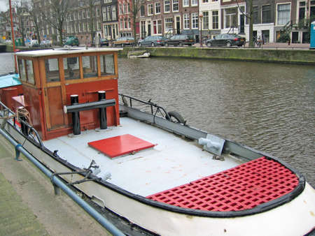 Typical Amsterdam boat on a canal, docked