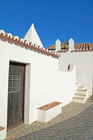 Typical houses and church from Algarve, Portugal