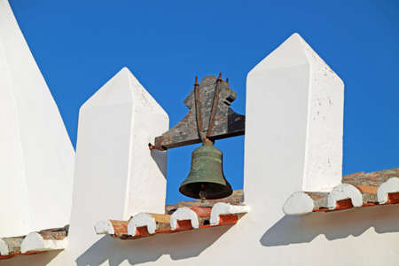Closeup view of a bell of an old church in Algarve, Portugal