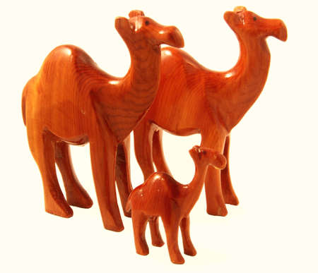 Handcraft Souvenir depicting three camels, isolated on white photo