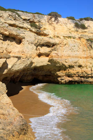 Typical Algarve beach with high cliffs