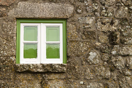 Green window of an old house, in Monsanto, Portugal Stock Photo - 9386230