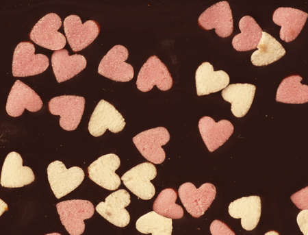 Detail of a Chocolate Bar with little Sugar Hearts Stock Photo