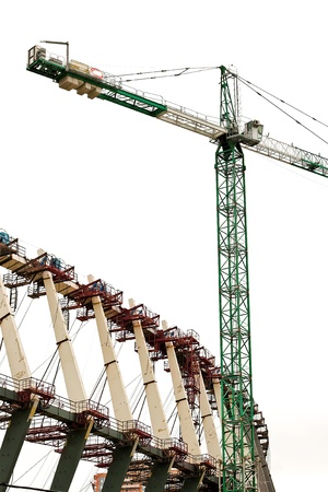 contruction: Sports Building Contruction Crane is at the top of a new high rise project in Kiev Ukraine