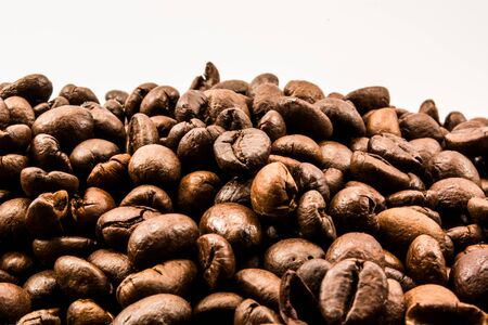 reiteration: Coffee beans shot against white background