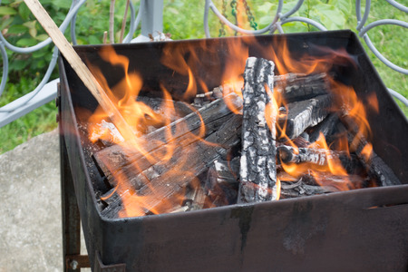 smolder: Closeup of logs burrning in preparation for nice barbecue