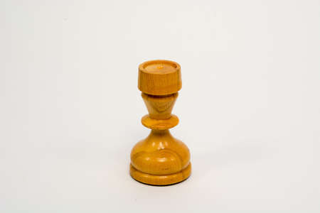 Old wooden chess piece white rook isolated on white background