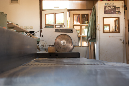 carpenter's bench: Circular saw in carpenters workshop
