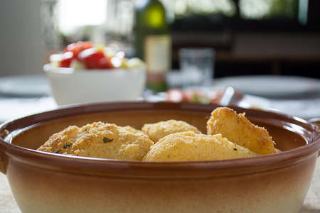 mouthwatering: Breaded potato fried in the dish. Blurred background