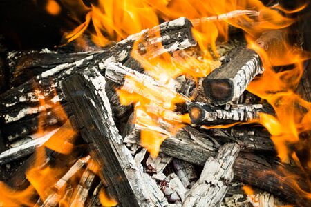 burned out: Close up of very hot campfire. Logs almost burned out Stock Photo