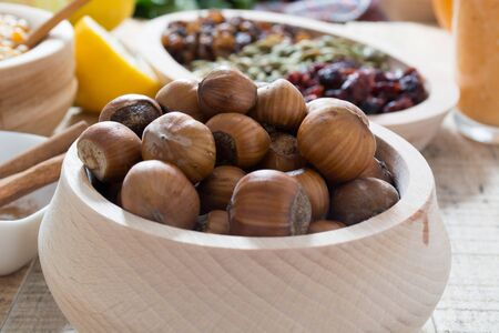 hazelnuts: Hazelnuts  in wooden bowl ready to be cracked and eaten Stock Photo