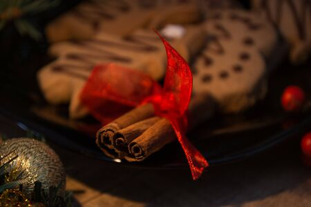 Atmospheric shoot of christmas eve with cookies and candles Stock Photo