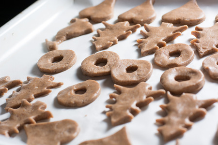 Preparing easter gingerbread cookies. Steps of making pastry. Stock Photo
