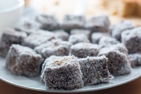 Close up of chocolate cakes with coconut flour on the ceramic plate Stock Photo