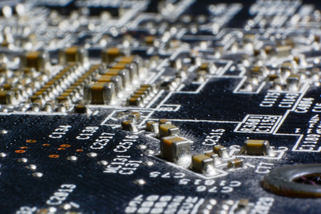hdmi: Surface-mount dusty smd components on used electronic circuit board close-up. Stock Photo