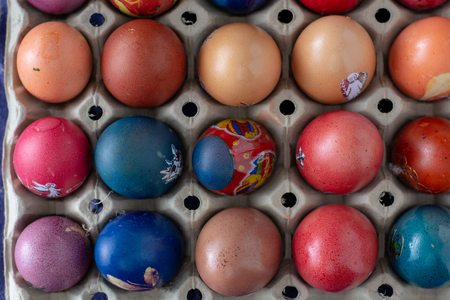Colorful Easter eggs in egg box. Painted Easter eggs in an egg carton, close up.