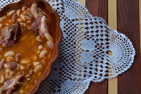 Beans with smoked pork on dinner plate Stock Photo