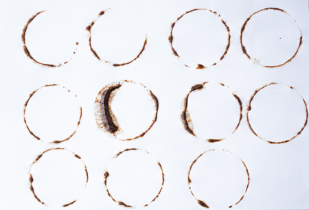 Coffee stains on white background. multiple shapes