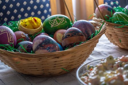 Table ful of food on easter holyday. Colored eggs and bread