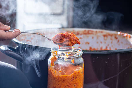 Freshly cooked ajvar in the glass jar. Shot from above