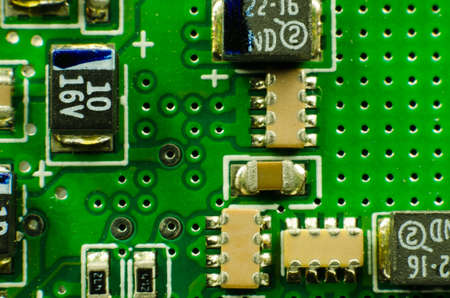 close up macro image of a circuit board with electronic components