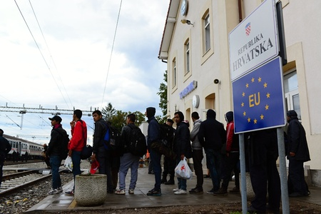 escapes: October 6,2015; Hegyeshalom in Hungary. Group of refugees leaving Hungary. They came to Hegyeshalom by train and then they leaving Hungary and go to Austria and then to Germany. Many of them escapes from home because of civil war.