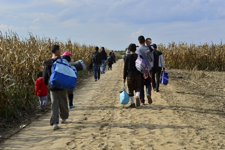 October 4, 2015; Sid in Serbia. Group of Afghan refugees leaving Serbia. They came to Sid by taxi and then they leaving Serbia and go to Croatia and then to Germany. Many of them escapes from home because of civil war.