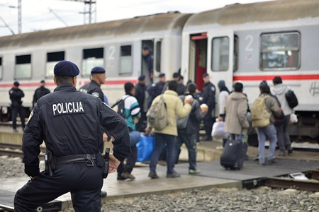 October 5, 2015; Tovarnik in Croatia. Croatian police assist refugees get into train which will go to Hungary.