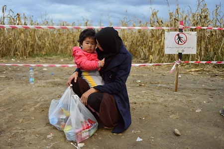 escapes: October 4, 2015; Bapska in Serbia. Group of refugees leaving Serbia. They came to Bapska by buses and then they leaving Serbia and go to Croatia and then to Germany. Many of them escapes from home because of civil war.